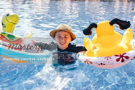 Portrait of boy in outdoor swimming pool