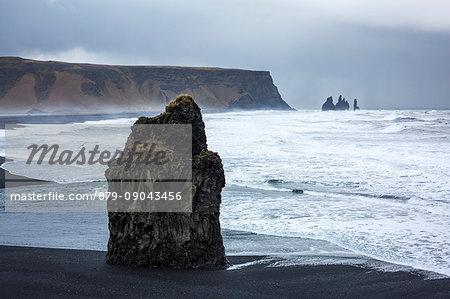 Solitary rock on the beach of Reynisfjara, Vik, Sudurland, Iceland, Europe