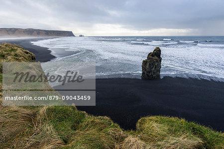 Solitary rock at the beach of Reynisfjara, Vik, Sudurland, Iceland, Europe