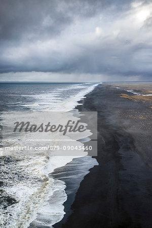 Aerial view of the long black sand beach of Reynisfjara, Vik, Sudurland, Iceland, Europe