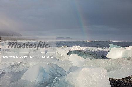 Ice blocks and rainbow. Jokulsarlon Glacier Lagoon, Eastern Iceland, Europe