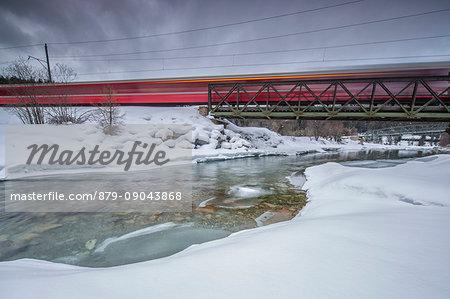 Bernina Express surrounded by snowy landscape Sankt Moritz Engadine Canton of Grisons Switzerland Europe