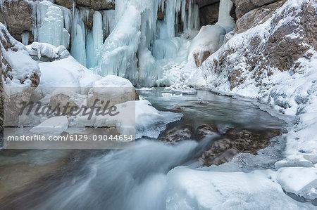 Europe, Italy, Veneto, Belluno, Sappada, Ice details in the Piave stream near the waterfall of Acqua Tona