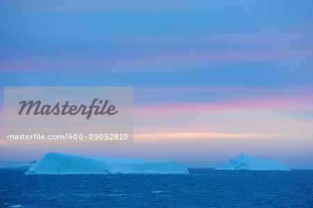 Icebergs on the Antarctic Sound at sunrise at the Antarctic Peninsula, Antarctica