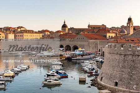Boats in Dubrovnik harbour during sunset, UNESCO World Heritage Site, Dubrovnik, Croatia, Europe
