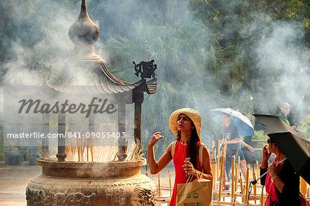 Burning incense at Po Lin Monastery, Ngong Ping, Lantau Island, Hong Kong, China, Asia