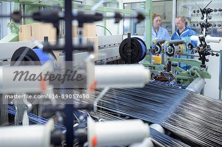 Carbon fibre thread on loom in carbon fibre production facility
