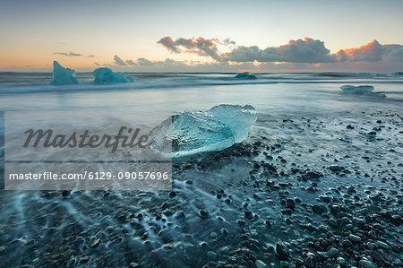 Block of ice on the black beach in Jokulsarlon Glacier Lagoon, Eastern Iceland, Europe