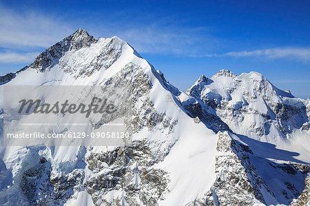 Aerial view of Pizzo Bernina and of Piz Roseg. Engadine, Canton of Grisons, Switzerland Europe