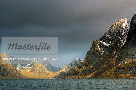 Dark clouds above rugged mountains, Reine, Lofoten, Norway