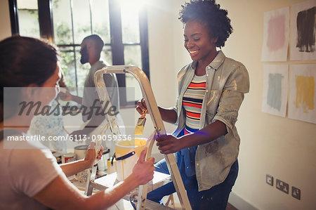 Women painting living room