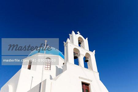 Classic Greek Orthodox church with blue dome, Oia, Santorini, Cyclades, Greek Islands, Greece, Europe