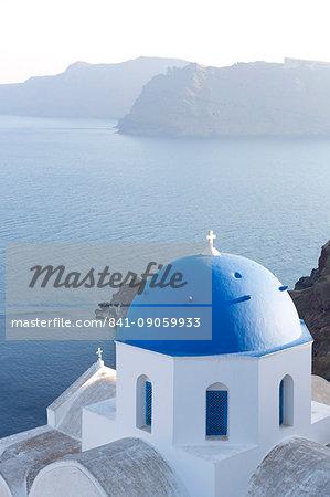 White church with blue dome overlooking the Caldera, Oia, Santorini, Cyclades Islands, Greek Islands, Greece, Europe