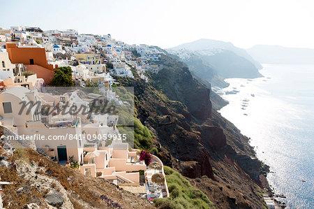 Early morning view of Oia, Imerovigli and Fira, from Oia, Santorini, Cyclades, Greek Islands, Greece, Europe