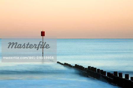 Groyne and post at sunset on Blyth Beach, Blyth, Northumberland, England, United Kingdom, Europe