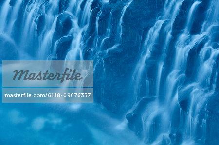 Close up of cobalt blue water cascading at White Beard Waterfall, Shirogane, Biei.