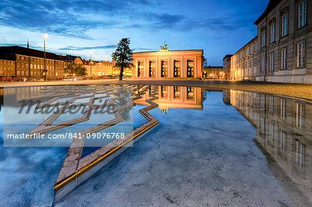 Thorvaldsens Museum reflected in the fountain of Bertel Thorvaldsen's Square at night, Copenhagen, Denmark, Europe