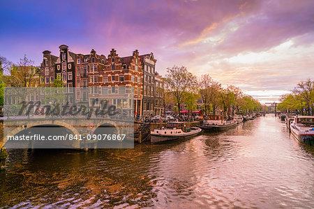 Canal scene at dusk, Amsterdam, Netherlands, Europe