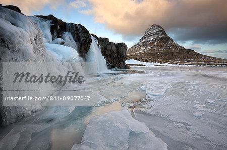 Kirkjufell (Church Mountain) in winter, with frozen waterfall, near Grundafjordur, Snaefellsnes Peninsula, Iceland, Polar Regions