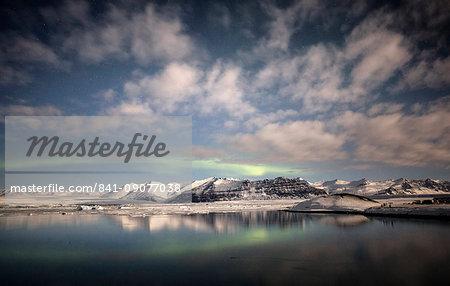 Weak winter Aurora Borealis (Northern Lights) over Jokulsarlon Glacial Lagoon, South Iceland, Polar Regions