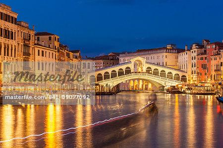 Rialto Bridge (Ponte di Rialto) at night with boat light trails on the Grand Canal, Venice, UNESCO World Heritage Site, Veneto, Italy, Europe