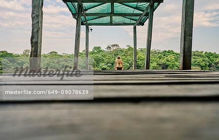 Surface level view of woman on pier, Aguas Calientes, Chuquisaca, Bolivia, South America