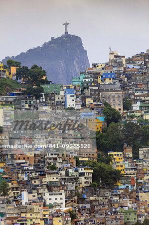 View of Rocinha favela (slum) (shanty town), Corcovado mountain and the statue of Christ the Redeemer, Rio de Janeiro, Brazil, South America