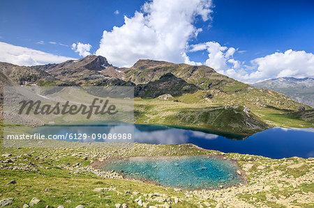 Blue water of alpine lake, Leg Grevasalvas, Julierpass, Maloja, canton of Graubünden, Engadin, Switzerland
