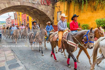 Horesback riders parade to the Parroquia de San Miguel Arcangel at the St Michael Archangel Festival in San Miguel de Allende, Mexico