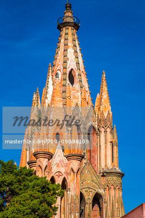 The turreted steeple of the Parroquia de San Miguel Arcangel in San Miguel de Allende, Mexico