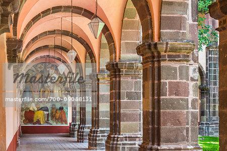 Colonnade with mural at the Bella Artes School (Escuela de Bellas Artes) in San Miguel de Allende, Mexico