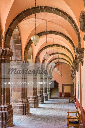 Colonnade with wooden benches at the Bella Artes School (Escuela de Bellas Artes) in San Miguel de Allende, Mexico