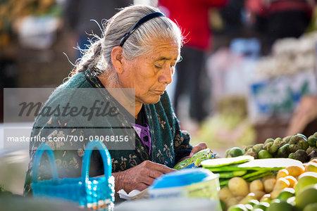 Close-up of woman selling vegetables at the Tianguis de los Martes (Tuesday Market) in San Miguel de Allende, Mexico