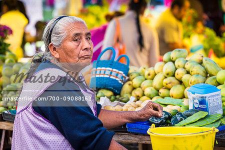 Portrait of woman selling fruit and vegetables at the Tianguis de los Martes (Tuesday Market) in San Miguel de Allende, Mexico
