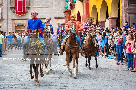 Historic horseback parade through streets of San Miguel de Allende celebrating Mexican Independence Day, Mexico
