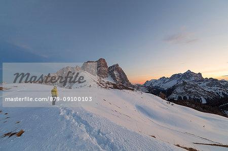 Hiker in front of Pelmo and Civetta from Col Roàn, Dolomites, Fiorentina Valley, Belluno, Borca di Cadore, Belluno, Veneto, Italy