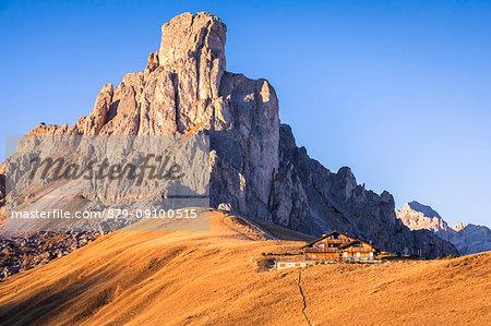 lonely chalet at the feet of La Gusela of the Averau, Dolomites, Giau pass, Colle Santa Lucia, Belluno, Veneto, Italy