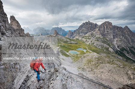 "Sesto / Sexten, province of Bolzano, Dolomites, South Tyrol, Italy. Climber on the via ferrata ""De Luca-Innerkofler"" to the Mount Paterno"