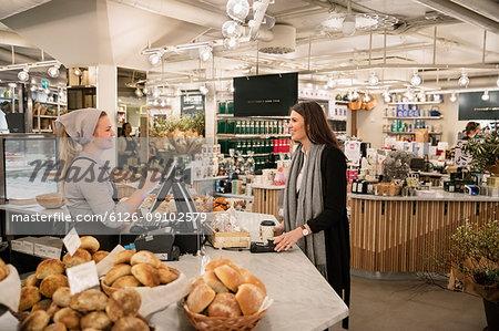 Woman shopping in bakery