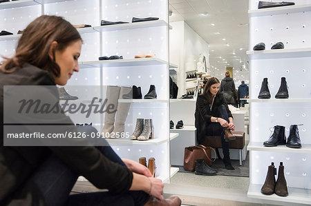 Woman choosing shoes in store