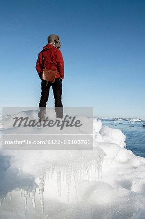 Man on ice in Biludden, Sweden