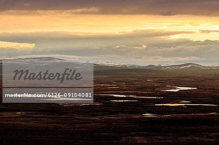 Sunset over mountains in Tavvavouma, Sweden