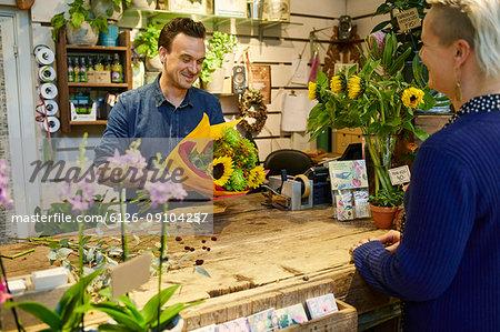 Florists working in flower shop