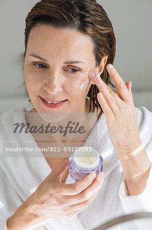 Woman Applying Moisturiser on Face
