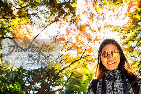 Woman with yellow sunglasses at Shinjuku Gyoen National Garden, Tokyo