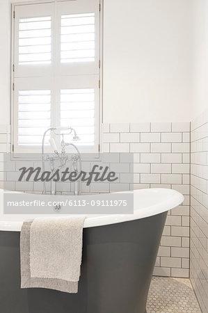 Luxury home showcase soaking tub in white bathroom