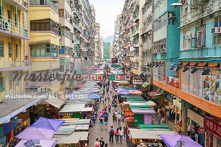 A busy market street in Mong Kok (Mongkok), Kowloon, Hong Kong, China, Asia