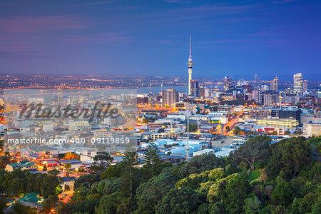 Cityscape image of Auckland skyline, New Zealand taken from Mt. Eden at dusk.