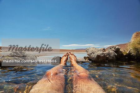 Man relaxing in water pool, low section, Salar de Chiguana, Chiguana, Potosi, Bolivia, South America