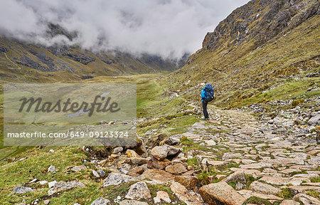 Woman trekking through landscape, Ventilla, La Paz, Bolivia, South America